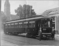 Train on Simcoe at Athol Street by old Library
